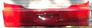 Picture of 2002-2004 Kia Spectra 4dr sedan; early design Rear Bumper Cover